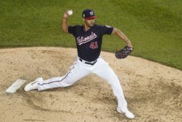 Washington Nationals reliever Joe Ross throws during the seventh inning of Game 3 of the baseball World Series against the Houston Astros Friday, Oct. 25, 2019, in Washington. (AP Photo/Pablo Martinez Monsivais)