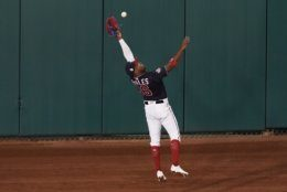 Washington Nationals' Victor Robles catches a fly ball hit by Houston Astros' Jose Altuve during the first inning of Game 3 of the baseball World Series Friday, Oct. 25, 2019, in Washington. (AP Photo/Pablo Martinez Monsivais)