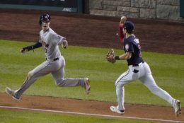 Houston Astros' Kyle Tucker is chase down by Washington Nationals' Trea Turner as he's caught in a rundown during the sixth inning of Game 3 of the baseball World Series Friday, Oct. 25, 2019, in Washington. (AP Photo/Alex Brandon)