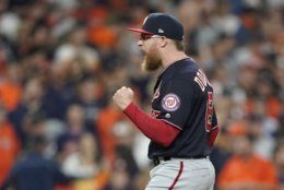 Washington Nationals' Sean Doolittle celebrates after Game 1 of the baseball World Series against the Houston Astros Tuesday, Oct. 22, 2019, in Houston. The Nationals won 5-4 to take a 1-0 lead in the series. (AP Photo/David J. Phillip)