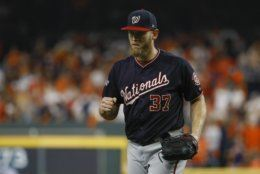 Washington Nationals starting pitcher Stephen Strasburg reacts after Houston Astros' Michael Brantley grounded out to end the fifth inning of Game 6 of the baseball World Series Tuesday, Oct. 29, 2019, in Houston. (AP Photo/Matt Slocum)