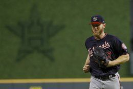 Washington Nationals starting pitcher Stephen Strasburg heads to the dugout after the third inning of Game 6 of the baseball World Series against the Houston Astros Tuesday, Oct. 29, 2019, in Houston. (AP Photo/Matt Slocum)