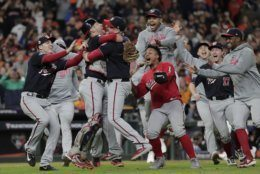 Washington Nationals' Yan Gomes and Daniel Hudson celebrate after Game 7 of the baseball World Series against the Houston Astros Wednesday, Oct. 30, 2019, in Houston. The Nationals won 6-2 to win the series. (AP Photo/David J. Phillip)