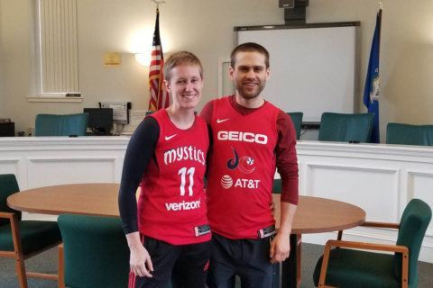 Mr. and Mrs. Mystics: Couple ties the knot before Game 4 — in matching jerseys