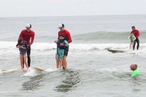 Man's bond with his son leads to surfing lessons for thousands of kids with autism