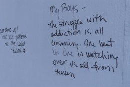 <p>People leave messages in an interactive exhibit that highlights opioid addiction.</p>