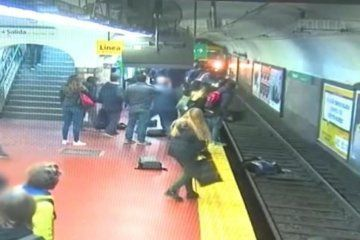 WATCH: Woman falls onto subway tracks and is pulled to safety