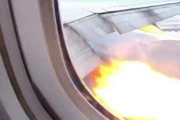 WATCH: A Boeing 777 lands safely back in Los Angeles after flames shoot from an engine
