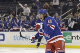 New York Rangers' Artemi Panarin (10) celebrates after scoring a goal during the second period of the team's NHL hockey game against the Washington Capitals on Wednesday, Nov. 20, 2019, in New York. (AP Photo/Frank Franklin II)