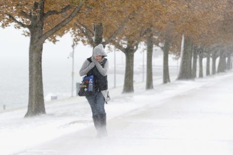 Record cold follows early snowstorm over much of eastern US