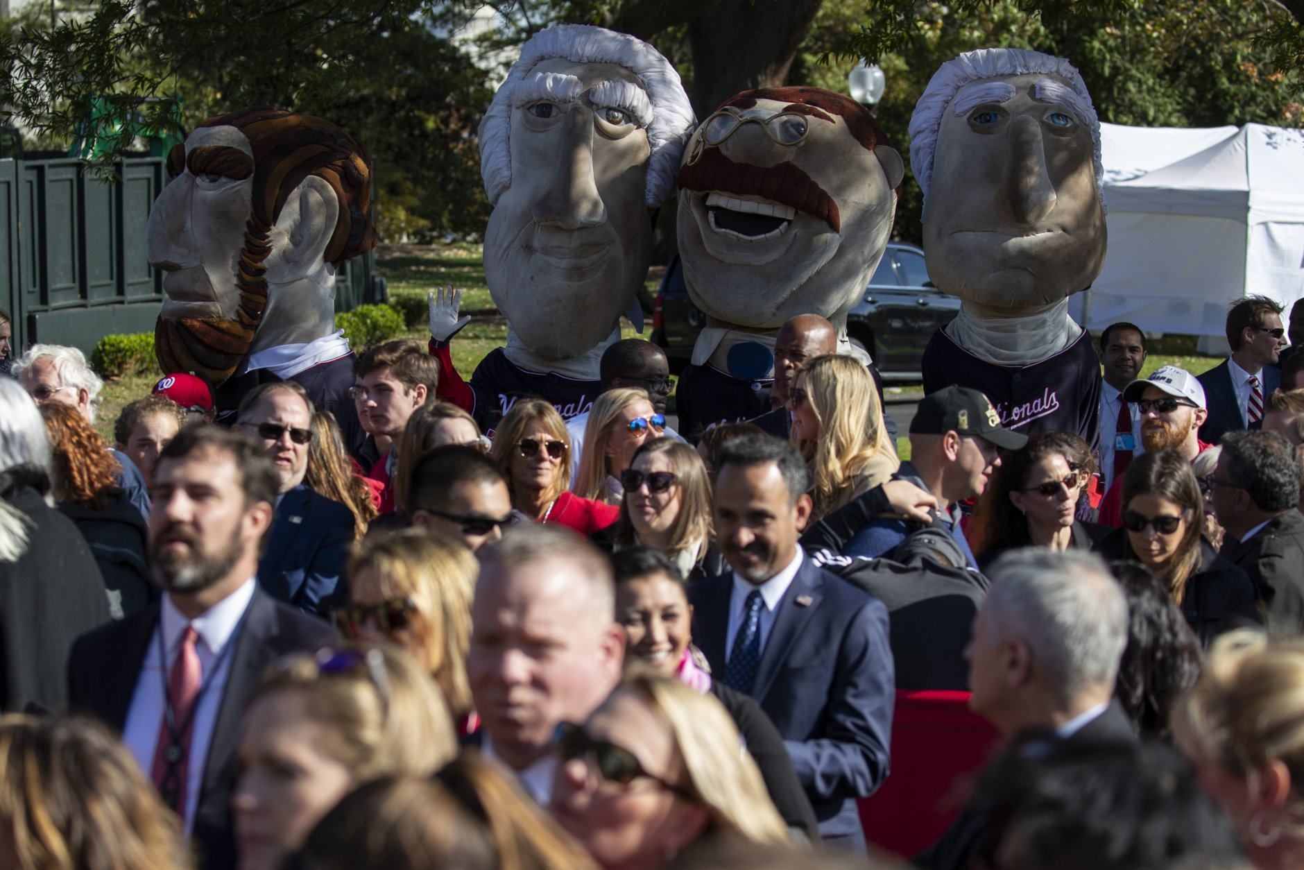 Fans watch during an event with President Donald Trump to honor the 2019 World Series Champion, Washington Nationals baseball team, at the White House, Monday, Nov. 4, 2019, in Washington. (AP Photo/ Evan Vucci)