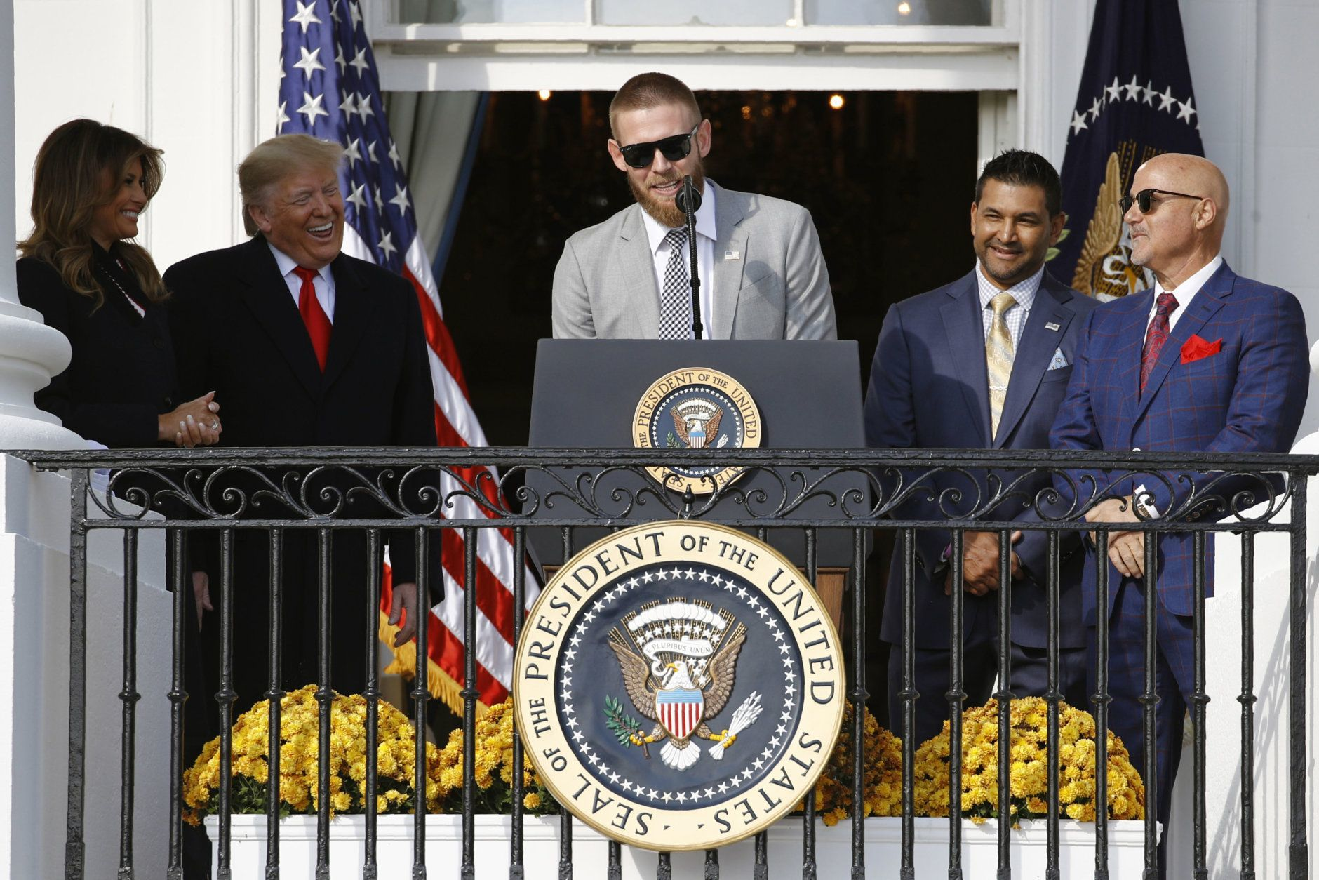 Washington Nationals starting pitcher Stephen Strasburg, center, speaks in front of first lady Melania Trump, from left, President Donald Trump, manager Dave Martinez and general manager Mike Rizzo during an event to honor the 2019 World Series champion Nationals baseball team at the White House, Monday, Nov. 4, 2019, in Washington. (AP Photo/Patrick Semansky)