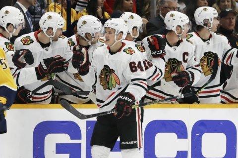 Kane stars as Blackhawks pound Predators 7-2