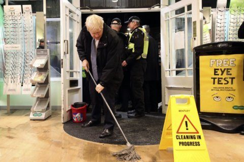 Floods become UK election issue as parties spar over funding