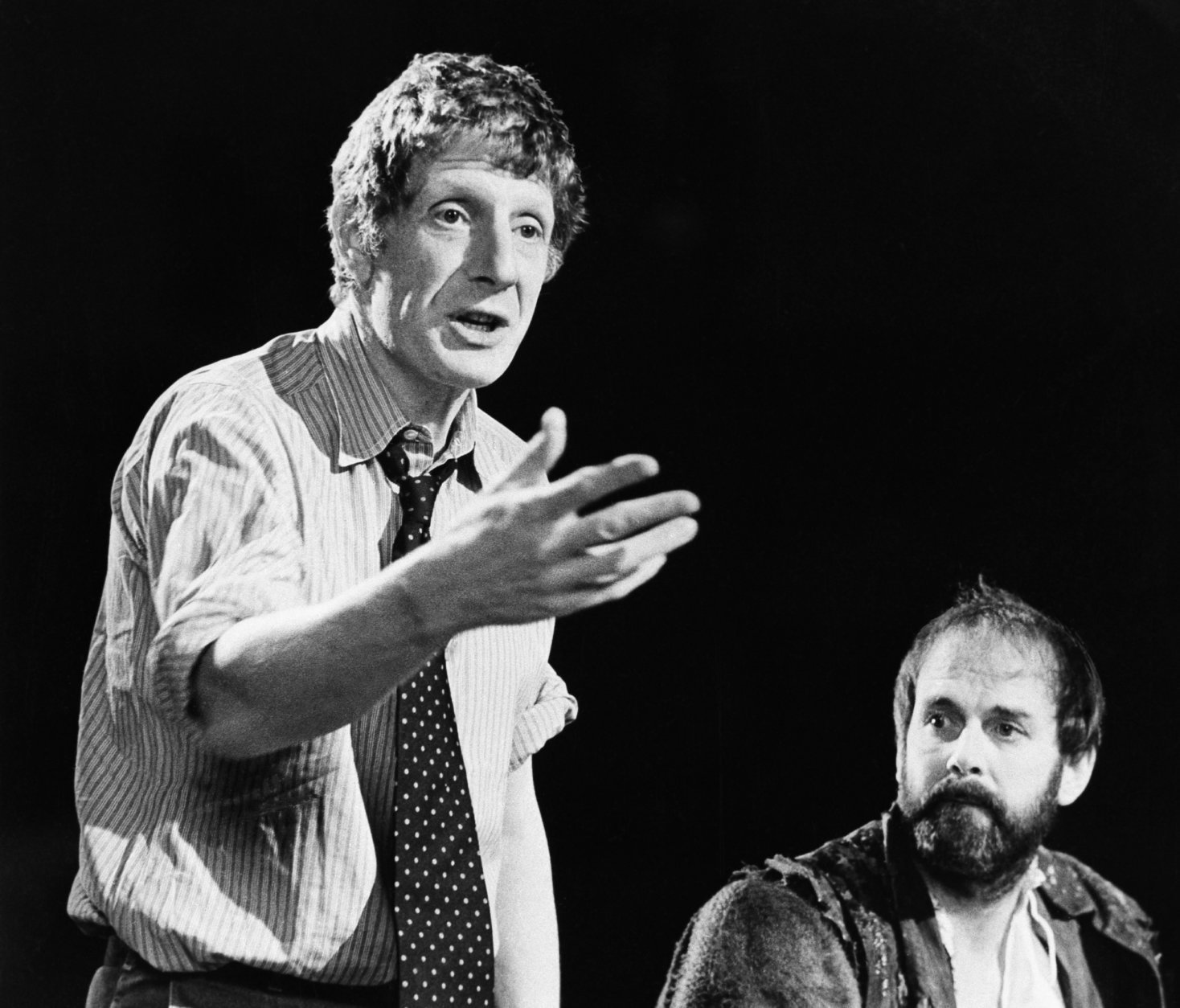 """FILE - In this Dec. 12, 1980 file photo, Jonathan Miller, left, directs Shakespeare's """"Taming Of The Shrew"""" with actor John Cleese, right. The family of theater director and presenter Jonathan Miller says the star of the """"Beyond the Fringe'' comedy revue has died. He was 85 and had suffered from Alzheimer's disease before his death Wednesday Nov. 27, 2019. (AP Photo, File)"""