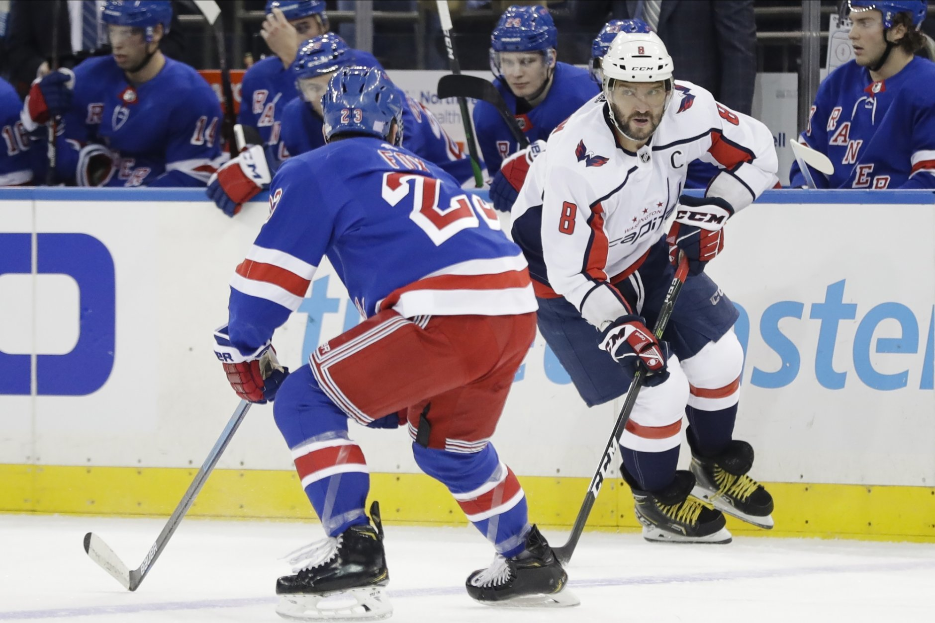 New York Rangers' Adam Fox (23) defends against Washington Capitals' Alex Ovechkin (8) during the first period of an NHL hockey game Wednesday, Nov. 20, 2019, in New York. (AP Photo/Frank Franklin II)