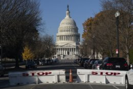 Barricades are raised on East Capitol Street as the U.S. Capitol and its office buildings were briefly evacuated amid concerns about a small aircraft in the area, in Washington, Tuesday, Nov. 26, 2019. (AP Photo/J. Scott Applewhite)