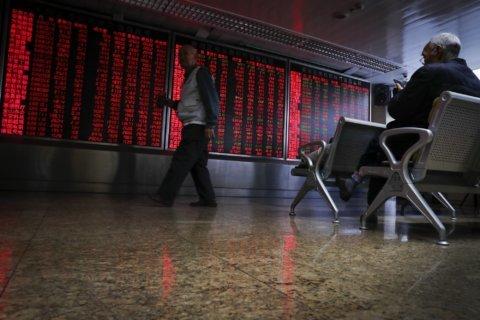 Asian shares slide on weak Japan data; US markets closed