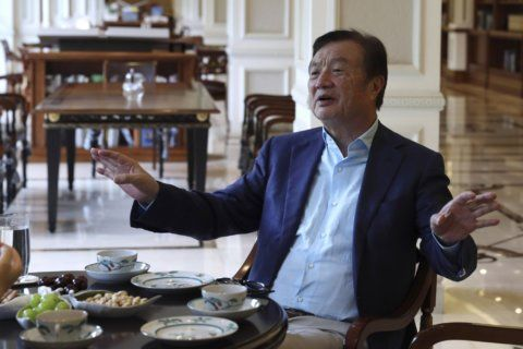 AP Interview: Huawei founder says US woes not hardest crisis