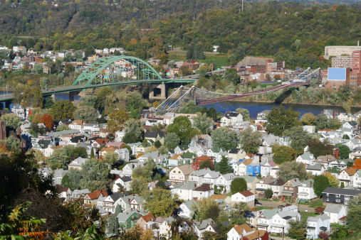 Wheeling, West Virginia. South Island in the foreground with two bridges across the Ohio River. Compressed houses in the foreground and bridges at middle.
