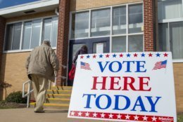 Voters make their way into the polling location at Abingdon High School Tuesday, Nov. 5, 2019 in Abingdon, Va. Along with the statewide races, voters in Washington County are voting on a new sheriff and a resolution concerning the future of their historic courthouse. (David Crigger/Bristol Herald Courier via AP)