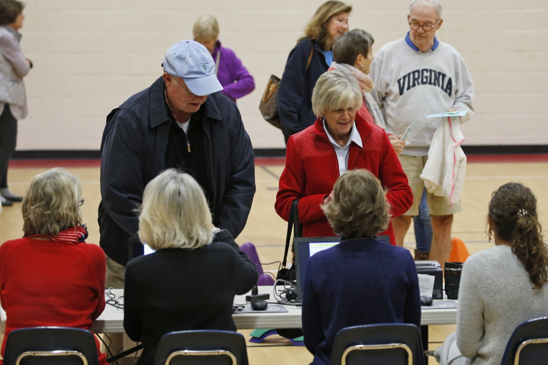 Voters line up to get ballots at a polling station in Richmond, Va., Tuesday, Nov. 5, 2019. All seats in the Virginia House of Delegates and State senate are up for election. (AP Photo/Steve Helber)