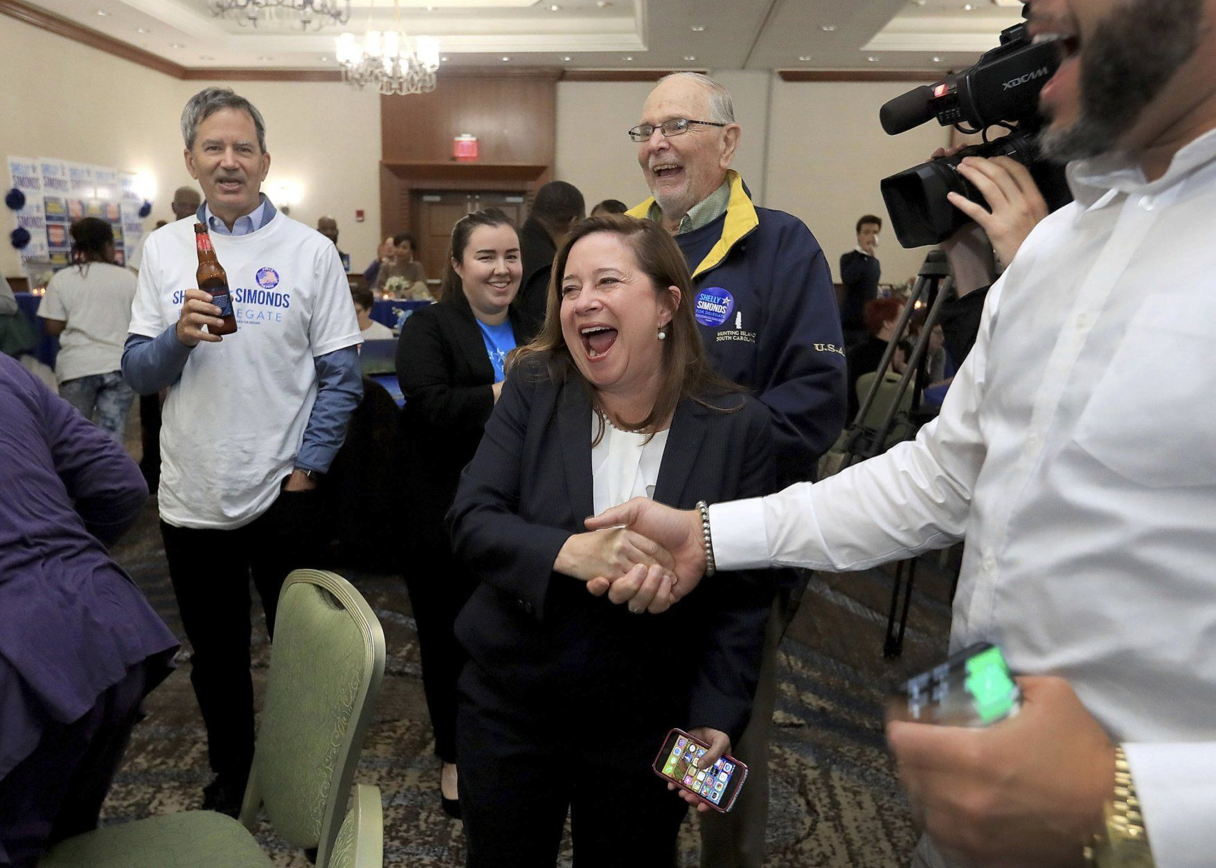 Candidate for the 94th District, Shelly Simonds, celebrates with supporters as election results begin to come in Tuesday, Nov. 5, 2019, at the Marriott in Newport News, Va. (Rob Ostermaier/The Virginian-Pilot via AP)
