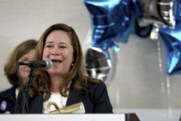 Candidate for the 94th District, Shelly Simonds,  delivers a speech to supporters Tuesday, Nov. 5, 2019, at the Marriott in Newport News, Va. (Rob Ostermaier/The Virginian-Pilot via AP)
