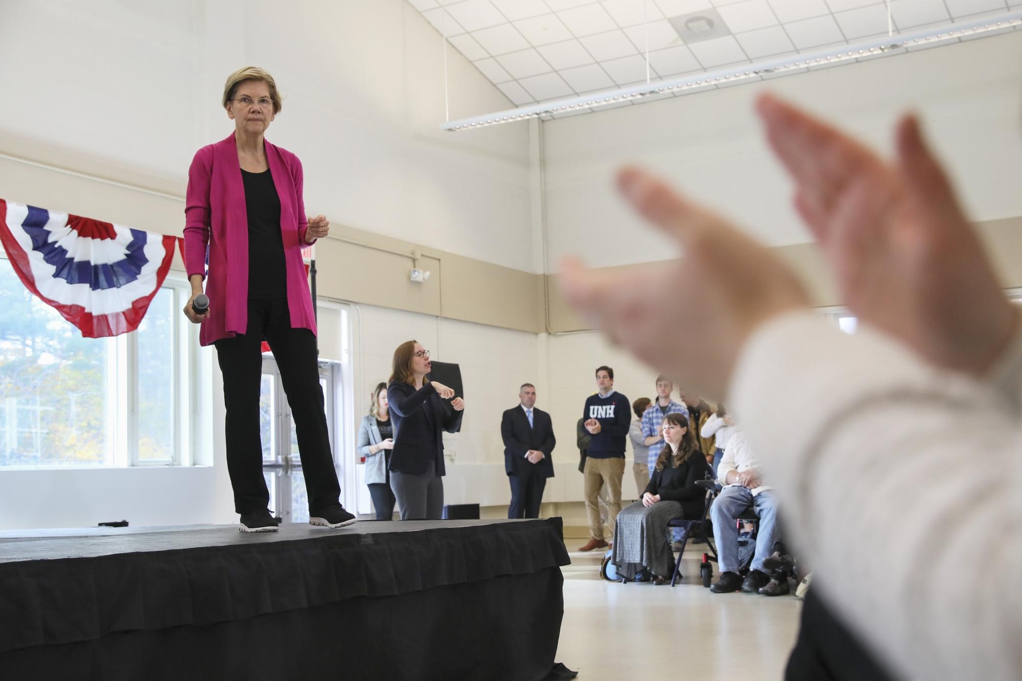 The Latest: Biden campaign faults Warren's health care ...