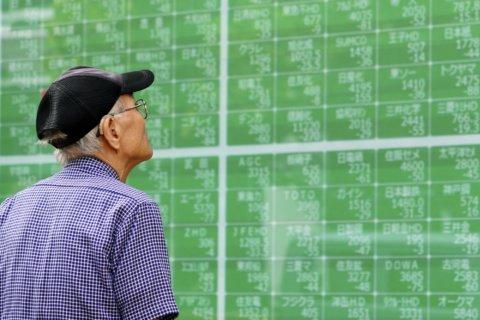 Global markets cautious as trade war talks grind on