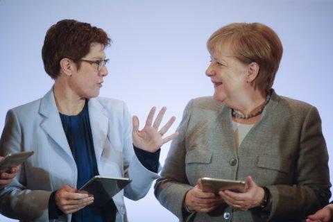 Merkel's heir apparent takes on critics, wins applause