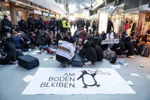 Climate protesters stage sit-in at Berlin's Tegel airport
