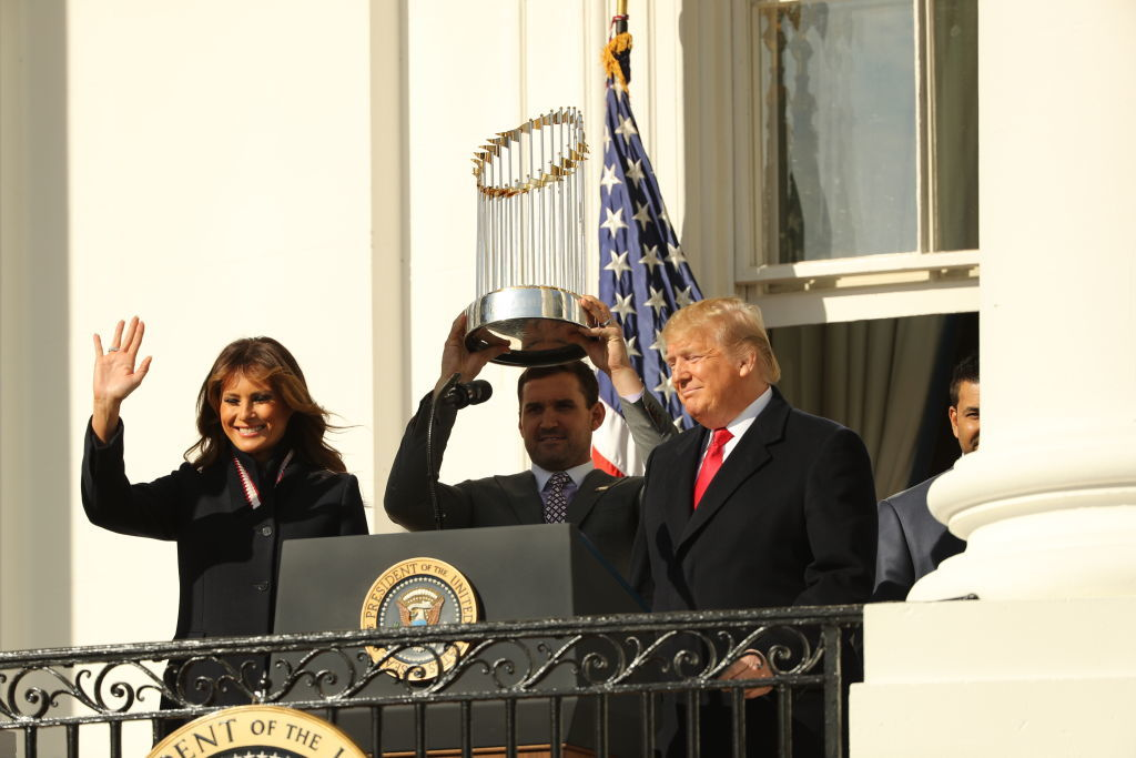 WASHINGTON, DC - NOVEMBER 04: First baseman Ryan Zimmerman (C) holds up the Commissioner's Trophy as U.S. President Donald Trump and first lady Melania Trump welcome the 2019 World Series Champions, the Washington Nationals, to the White House November 4, 2019 in Washington, DC. The Nationals are Washington's first Major League Baseball team to win the World Series since 1924. (Photo by Chip Somodevilla/Getty Images)