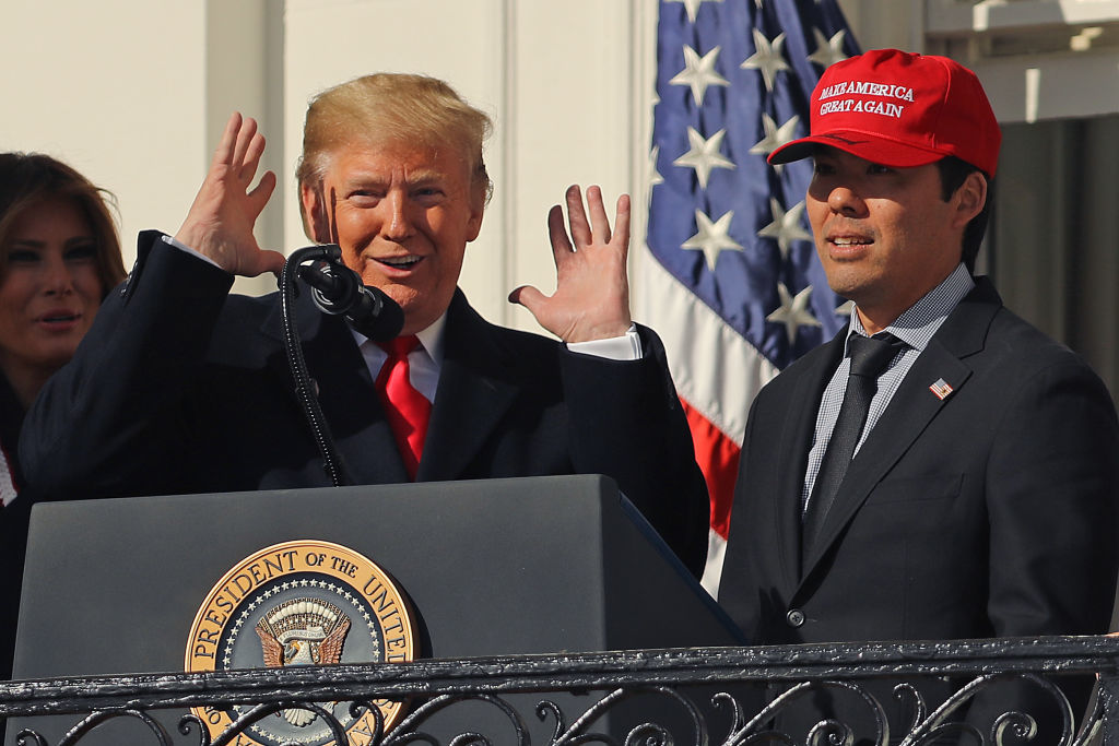 WASHINGTON, DC - NOVEMBER 04: U.S. President Donald Trump reacts to Washington National catcher Kurt Suzuki wearing a 'Make America Great Again' cap during a celebration of the 2019 World Series Champions at the White House November 04, 2019 in Washington, DC. The Nationals are Washington's first Major League Baseball team to win the World Series since 1924. (Photo by Chip Somodevilla/Getty Images)
