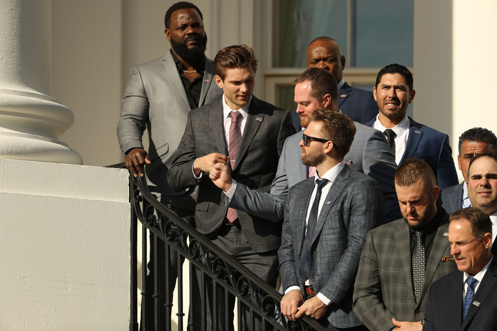 WASHINGTON, DC - NOVEMBER 04: 2019 World Series Champions Washington Nationals players (front row L-R) Fernando Rodney, Trea Turner, Aaron Burnett, Brian Dozier, Matt Adams and others stand on the Truman Balcony during a celebration of their victory at the White House November 04, 2019 in Washington, DC. The Nationals are Washington's first Major League Baseball team to win the World Series since 1924. (Photo by Chip Somodevilla/Getty Images)
