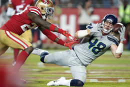 """<p><b><i>Seahawks 27</i></b><br /> <b><i>49ers 24 (OT)</i></b></p> <p>In what was <a href=""""https://twitter.com/ESPNStatsInfo/status/1191161869802917888?s=20"""">the game of the year in more ways than one</a>, defense dominated most of the way (a combined 10 sacks, seven turnovers and two defensive touchdowns) before unheralded field goal kickers threatened to make this the first tie game on Monday Night Football since 1983. But Russell Wilson solidified his status as MVP frontrunner by saving us all from the dreaded non-result and pulled Seattle within a half game of San Fran in the best division in football.</p>"""