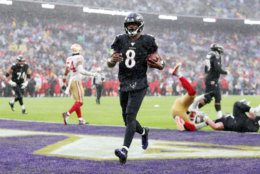 """<p><b><i>49ers 17</i></b><br /> <b><i>Ravens 20</i></b></p> <p>In an <a href=""""https://wtop.com/baltimore-ravens/2019/11/49ers-vs-ravens-showdown-highlights-week-13-action/"""" target=""""_blank"""" rel=""""noopener"""" data-saferedirecturl=""""https://www.google.com/url?q=https://wtop.com/baltimore-ravens/2019/11/49ers-vs-ravens-showdown-highlights-week-13-action/&amp;source=gmail&amp;ust=1575342523390000&amp;usg=AFQjCNH-d5C_kltR-LtFoFPhKdWUSSjODA"""">unprecedented late-season matchup</a> between heavyweights, Lamar Jackson again turned in a highlight-reel performance to <a href=""""https://profootballtalk.nbcsports.com/2019/12/01/lamar-jackson-notches-record-fourth-double-triple-of-season/"""" target=""""_blank"""" rel=""""noopener"""">create a new stat</a> and lead Baltimore to franchise records for touchdowns in a season (49), consecutive wins (8), and best 12-game start to a season at 10-2. The <a href=""""https://www.espn.com/nfl/story/_/id/28176961/earl-thomas-says-ravens-super-bowl"""" target=""""_blank"""" rel=""""noopener"""" data-saferedirecturl=""""https://www.google.com/url?q=https://www.espn.com/nfl/story/_/id/28176961/earl-thomas-says-ravens-super-bowl&amp;source=gmail&amp;ust=1575342523390000&amp;usg=AFQjCNHs5Gaz_4WZkflfxkYcD7dgPWsZlg"""">Super Bowl talk</a> is absolutely warranted and everyone — <a href=""""https://www.espn.com/nfl/story/_/id/28206390/niners-hoping-super-rematch-ravens"""" target=""""_blank"""" rel=""""noopener"""">even the team that lost</a> — wants to see a rematch of this game.</p>"""