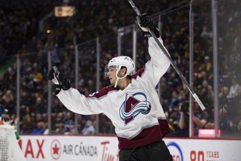 MacKinnon scores in OT, Avalanche beat Canucks 5-4