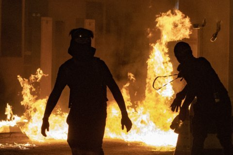 AP Photos: Hong Kong protesters resort to medieval weapons