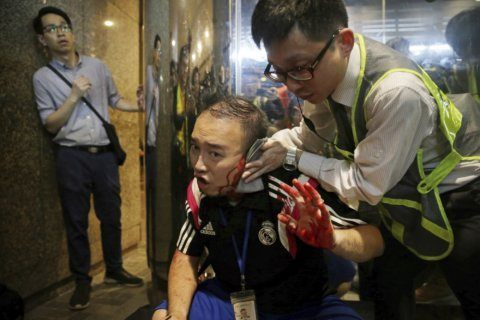Hong Kong police arrest man in knife attack at protest site