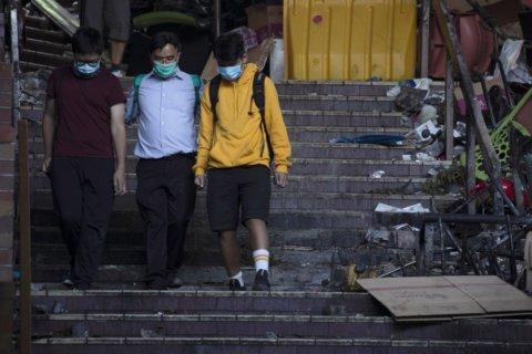 Police surround last holdouts at Hong Kong university
