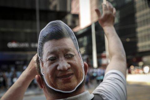 The Latest: China furious as Trump signs Hong Kong bills