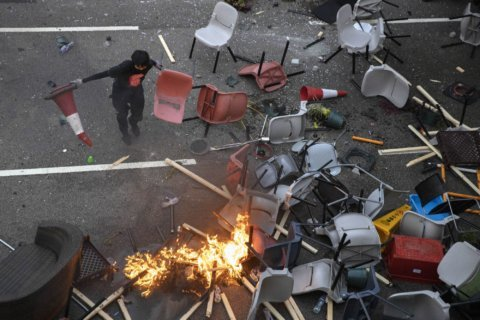 Hong Kong endures more transit disruptions, campus violence