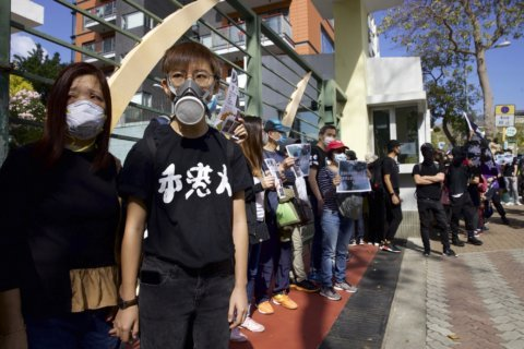 Hong Kong families protest police use of tear gas
