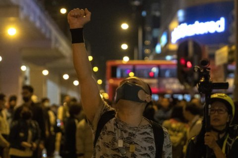 The Latest: Riot police out in force for Hong Kong march