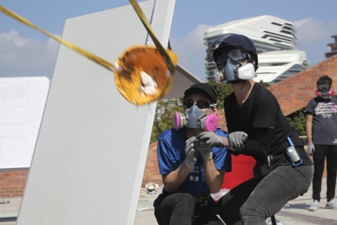 AP Photos: Violence engulfs Hong Kong university campus