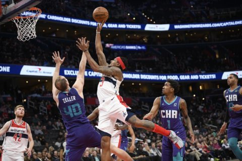 Beal, Bryant rally Wizards to 125-118 win over Hornets