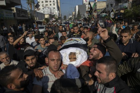 The Latest: New Israel defense minister warns Gaza militants