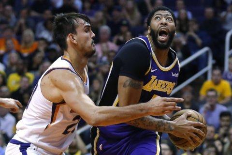 Kuzma's late 3-pointers help Lakers push past Suns 123-115