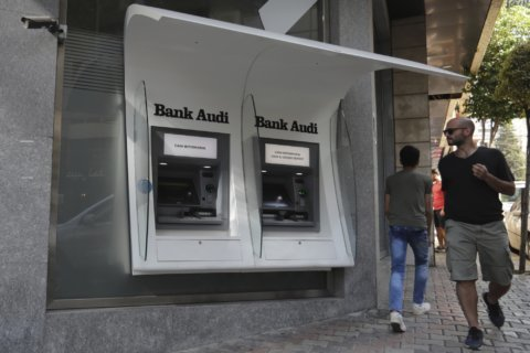 Lebanese banks to reopen as withdrawal limits made official